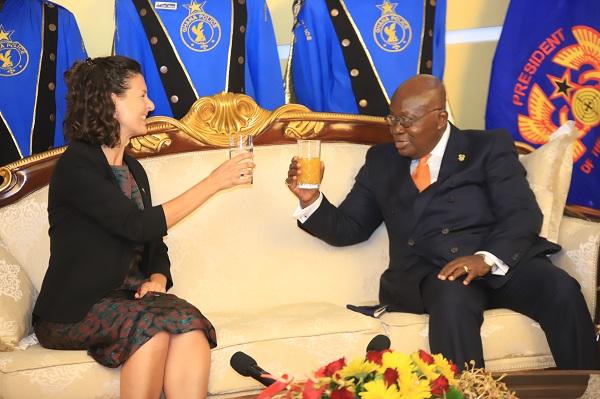 President Nana Addo Dankwa Akufo-Addo proposing a toast to Ms Harriet Thompson (left), British Ambassador to Ghana at the Jubilee House.
